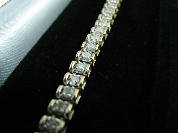 7: 10K YG & Diamond tennis bracelet