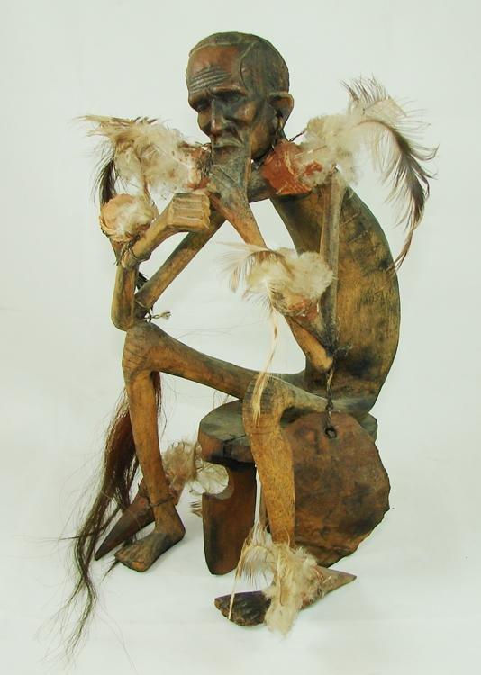 16: African wood carving Ceremonial Smoking Man