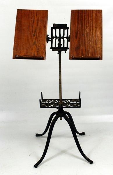 antique cast iron book stand