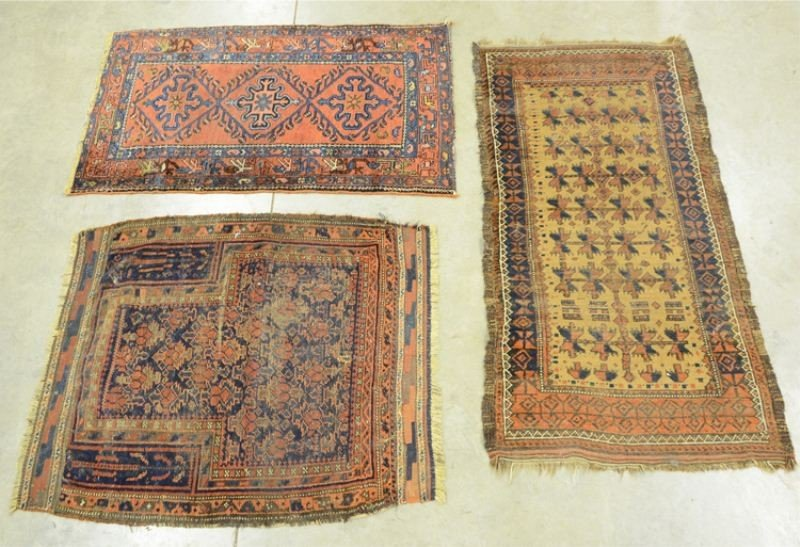 11: Group of three oriental Throw Rugs