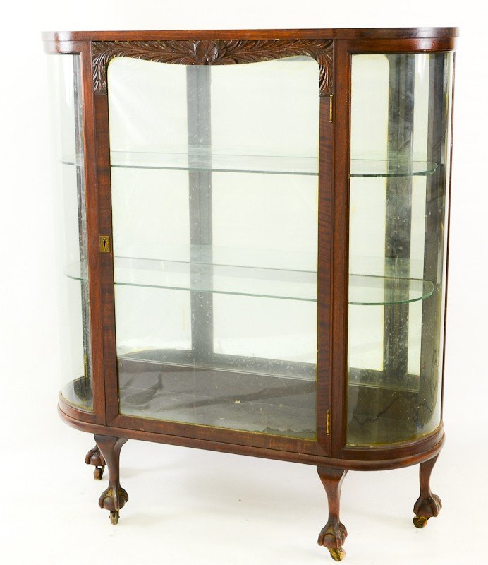 26: Curved glass carved mahogany china cabinet
