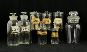 8 glass apothecary bottles and jars