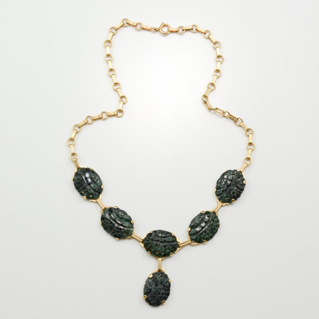 A Suite of Jade & Gold Jewelry - 2