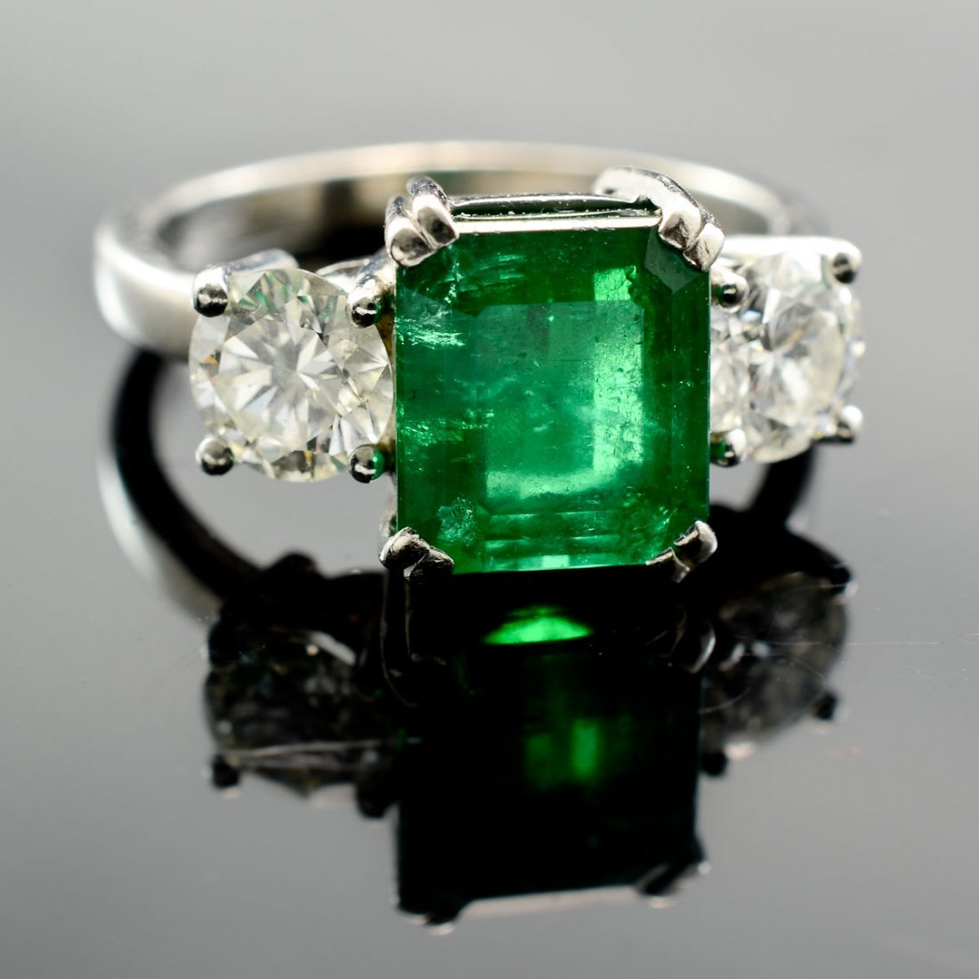 A platinum, Emerald and Diamond Ring