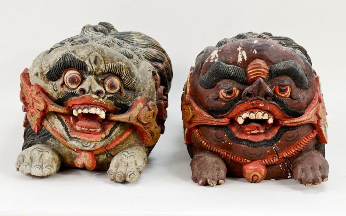 Pair of Asian Foo Dog carvings