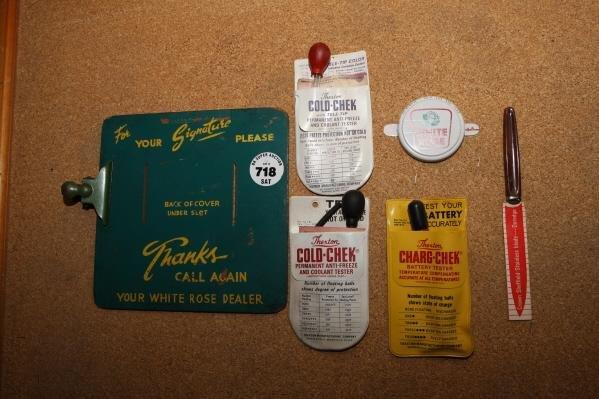 718: White Rose clipboard & battery tester adv't