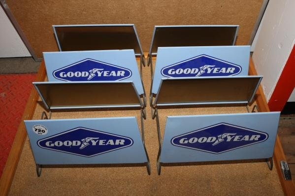 720: 4 - Goodyear tire stands