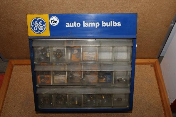 722: GE auto lamp cabinet