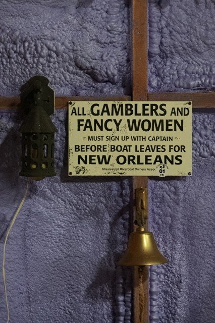 1:  Gamblers Sign, Cast wall mount light and Brass bell