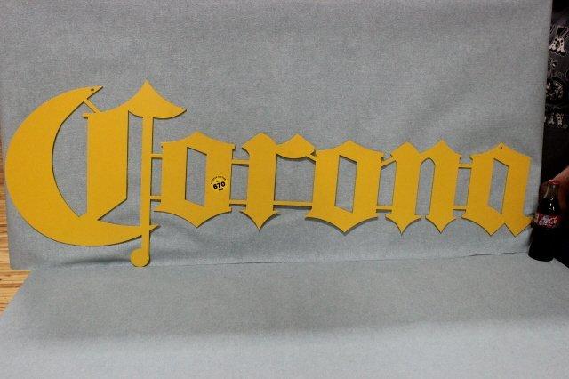 670: CORONA SIGN  LASER CUT METAL