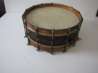 5: Early drum with sticks