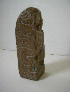7: Antique carved chop