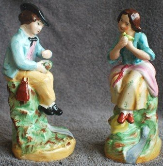 12: Pair of Old Staffordshire Porcelain Figurines