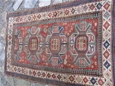 147: Antique Kazak  5' x 8' rug