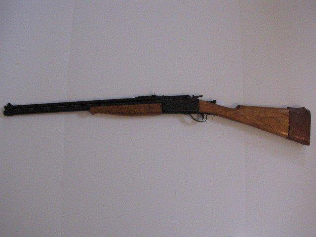 418: Over/under gun, .22 cal/12 ga.
