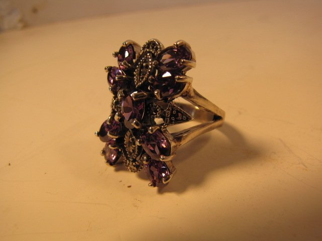 20: Ring, sterling silver w/ purple stones 11.2 g
