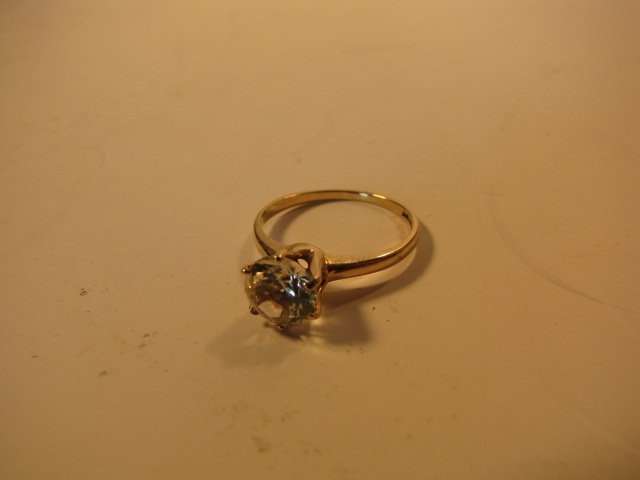 23: Ring, 10k gold w/ clear stone 2 g