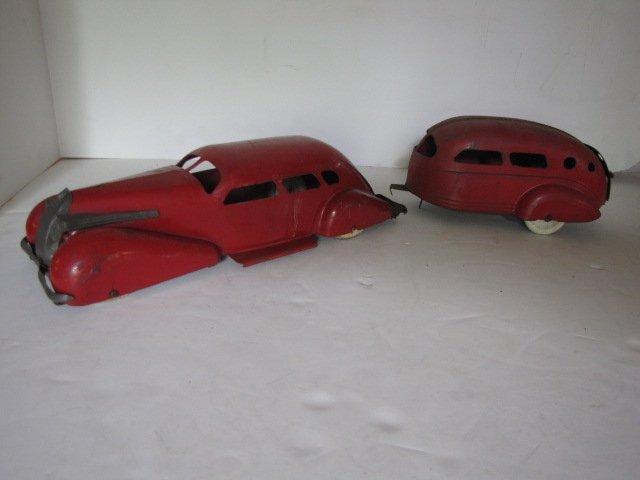 74: 2 pc. tin car and camper