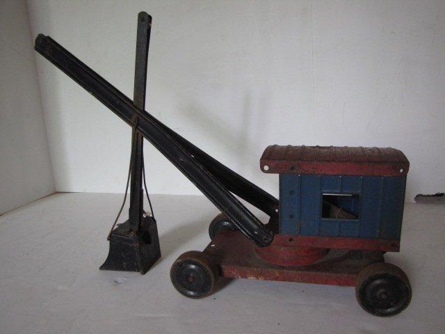 76: Tin toy steam shovel