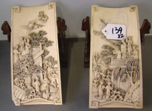 139: PAIR OF ANTIQUE CARVED IVORY PLAQUES
