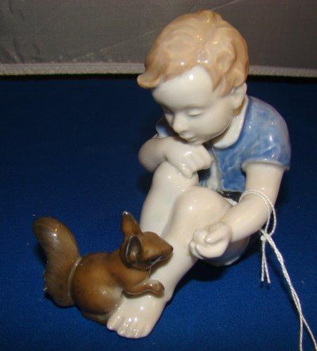18: ROSENTHAL FIGURINE OF A BOY FEEDING A SQUIRREL