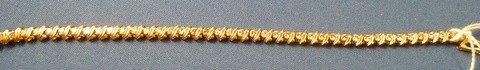320: 18 KT YELLOW GOLD AND DIAMOND TENNIS BRACELET