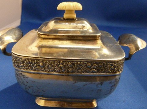 315: ANTIQUE RUSSIAN STERLING AND IVORY COVERED VESSEL.
