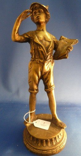 7: BRONZE OF A YOUNG SWISS BOY WITH TABLET