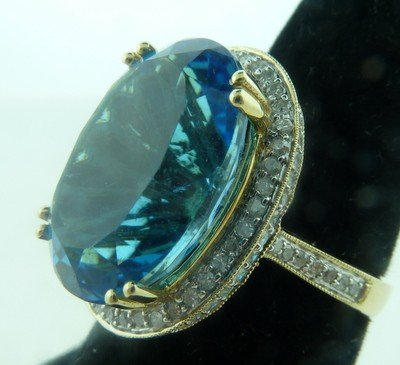 23: 13CT BLUE TOPAZ GOLD AND DIAMOND RING