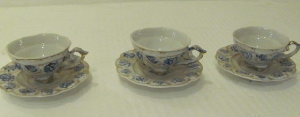 7: Set of three hand Painted Porcelain tea cups
