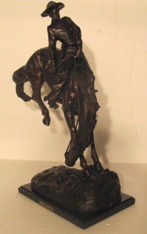 "134: Remington ""Outlaw"" statue recast"