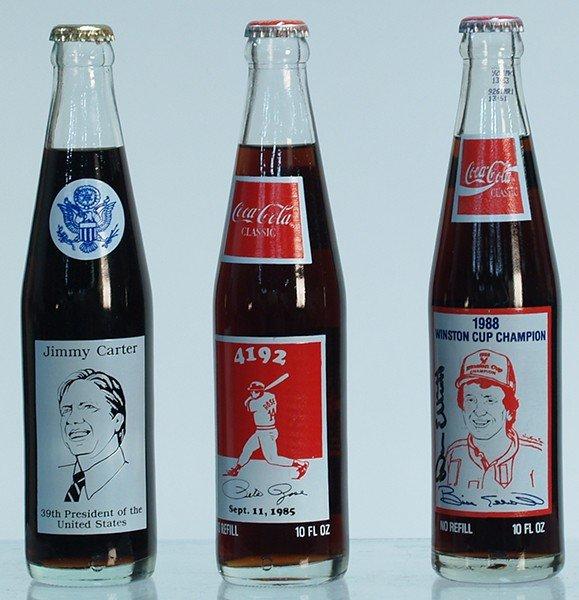 219: Lot Of 3 Commemorative Unopened Coca Cola Bottles: