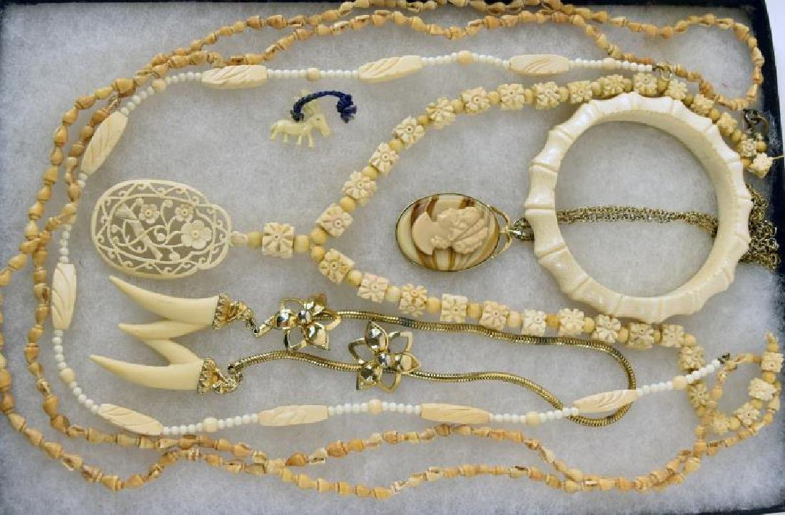 Carved Off White And Shell Jewelry