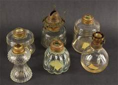 A Group Of Small Vintage Oil Lamps