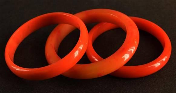 Three Orange Bakelite Bangle Bracelets