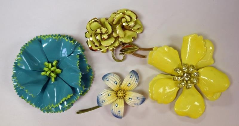 Four Mid-Century Metal Flower Pins