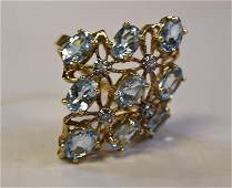 14 K Yellow Gold and Blue Topaz Ring
