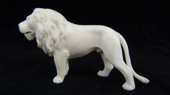 9: CONTINENTAL IVORY HAND CARVED LION FIGURE