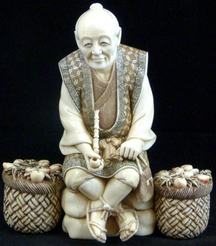 20: CHINESE IVORY CARVING DEPICTING PEACH MERCHANT