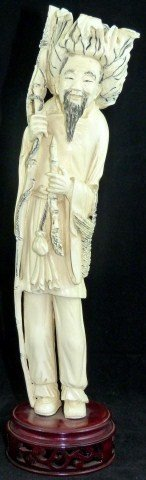 21: CHINESE IVORY FIGURE OF FISHERMAN WITH PIPE