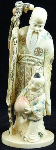 24: CHINESE IVORY CARVING OF SAU WITH YOUNG BOY