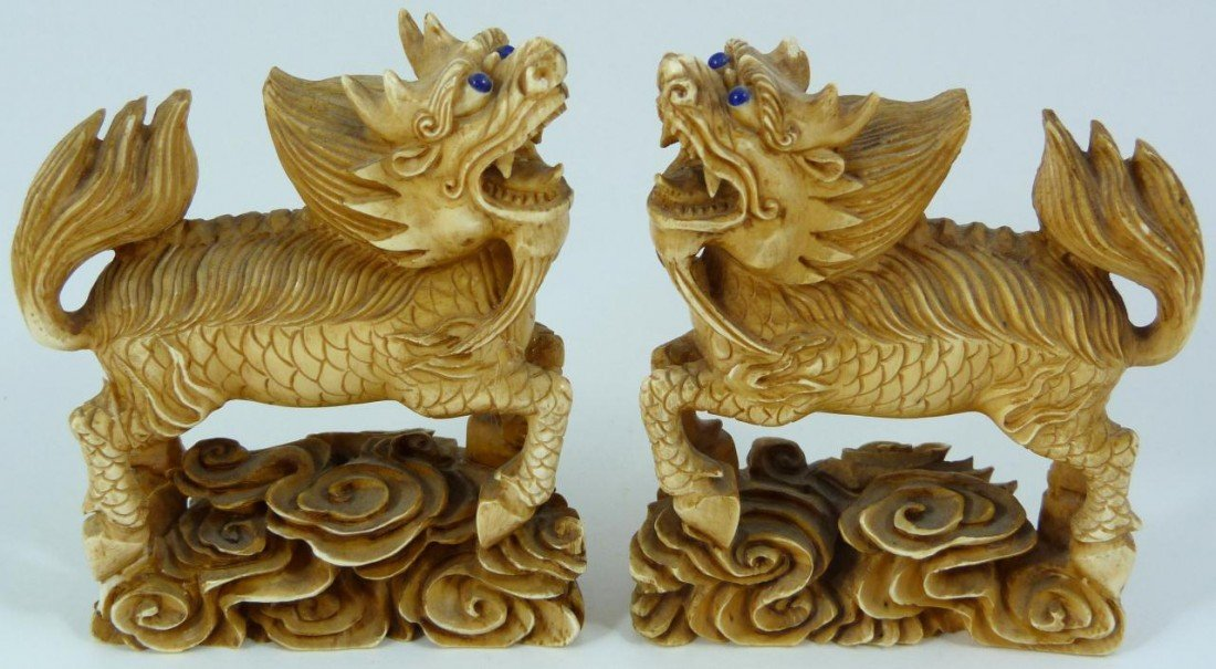 20: PAIR OF CHINESE IVORY HAND CARVED KYLIN FIGURES