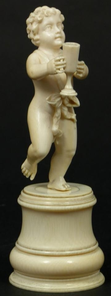 20: CONTINENTAL IVORY CARVED PUTTI WITH GOBLET