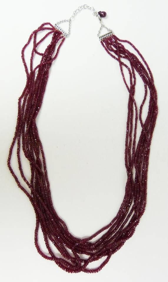 61: 14K WHITE GOLD 8 STRAND RUBY BEADED NECKLACE