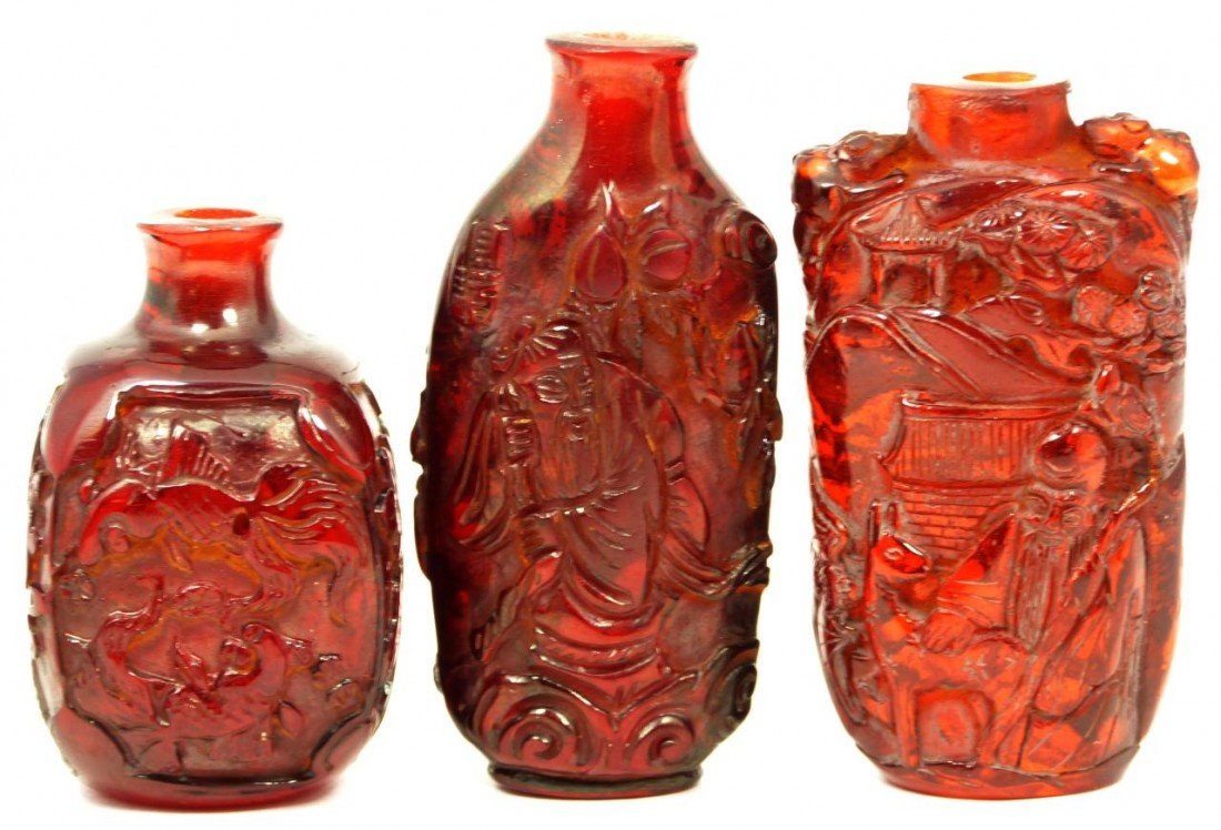 5: 3 CHINESE HAND CARVED AMBER SNUFF BOTTLES