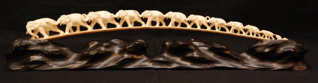 215: CHINESE HAND CARVED IVORY ELEPHANT BRIDGE