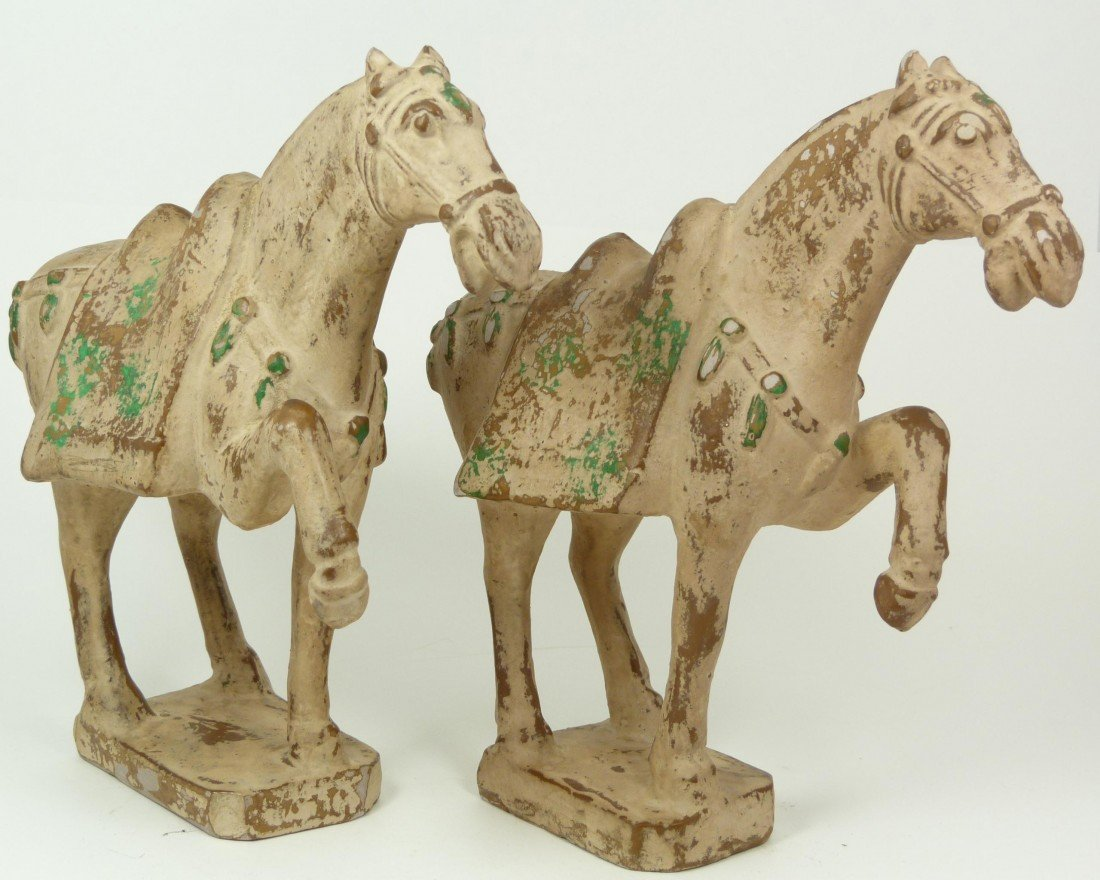 575: PAIR OF TANG DYNASTY UNGLAZED POTTERY HORSES
