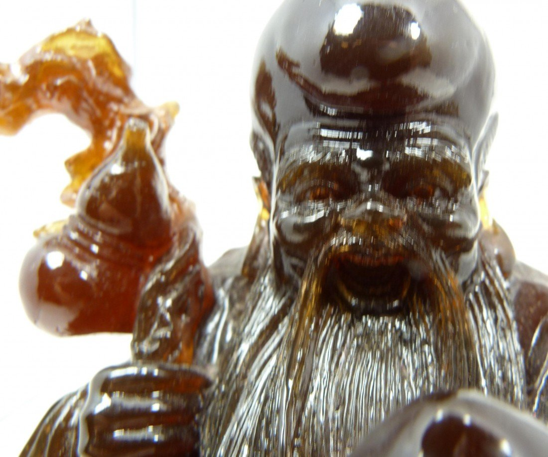 587: ANTIQUE CHINESE CARVED AMBER SHOU XING FIGURE - 8