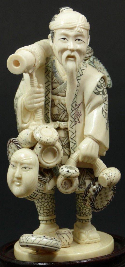 412: JAPANESE IVORY FIGURE OF TRAVELING MERCHANT SIGNED