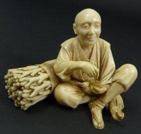 19th C JAPANESE IVORY STUDY OF MAN EATING RICE